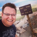 the-author-at-mt-evans-sign